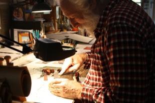Alan carves the 'Treetops' wood block